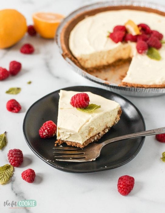 slice of dairy free gluten free lemon cheesecake with a bite taken