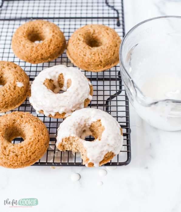 top eight allergen free carrot cake donuts with vegan cream cheese glaze on a wire rack
