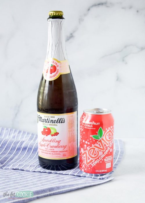 bottle of martinelli's sparkling juice next to can of grapefruit zevia