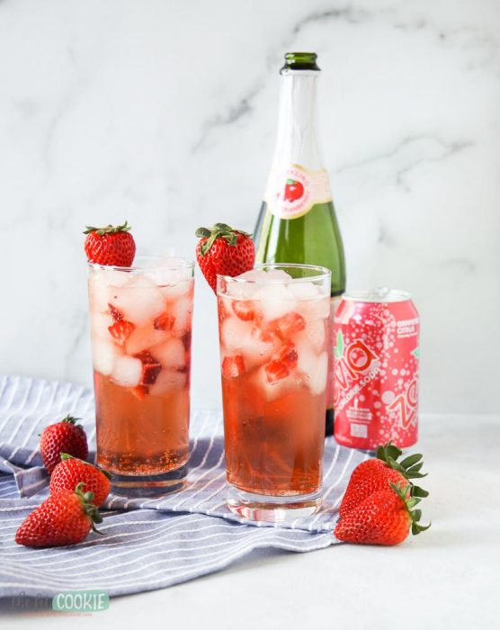 glasses of sparkling grapefruit mocktail in front of a marble background
