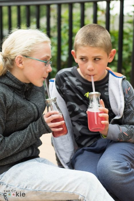 kids sitting on deck drinking juice