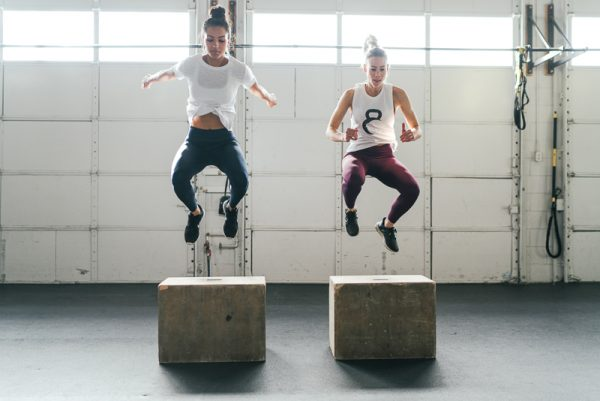photo of 2 women doing box jumps in zyia active clothing