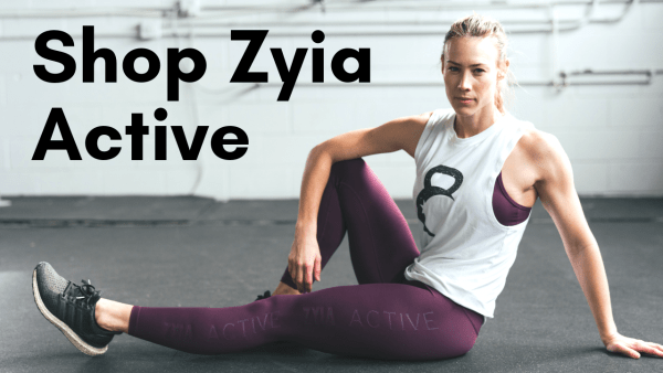 photo of woman sitting in a gym wearing zyia fitness clothing