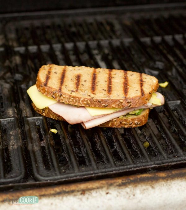 sandwich cooking on a grill