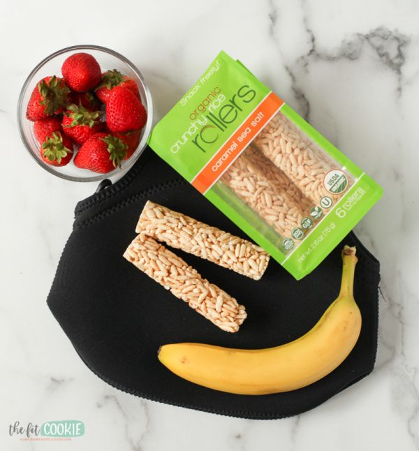 Overhead photo of lunch bag with strawberries, banana, and Crunchy Rollers