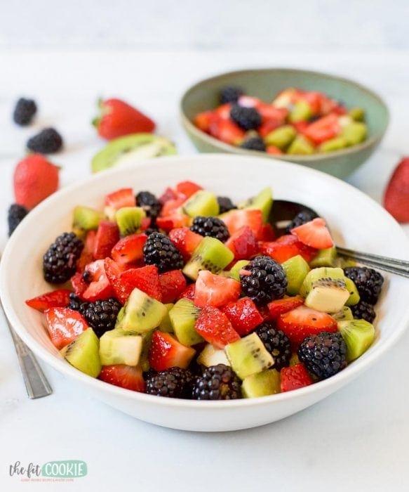close up photo of paleo blackberry kiwi fruit salad in a white bowl