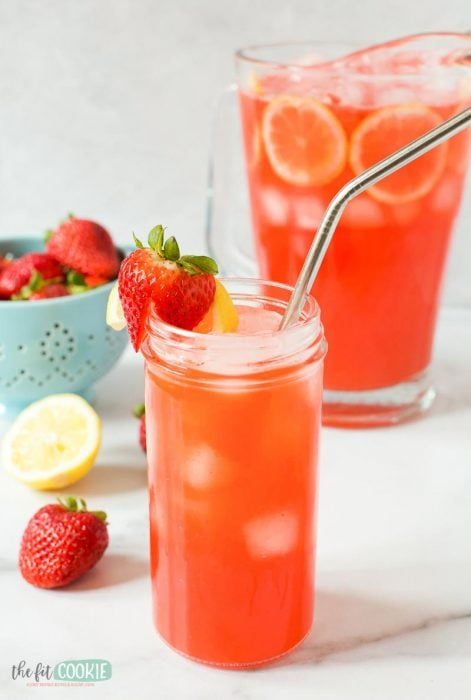 glass of paleo strawberry lemonade with metal straw