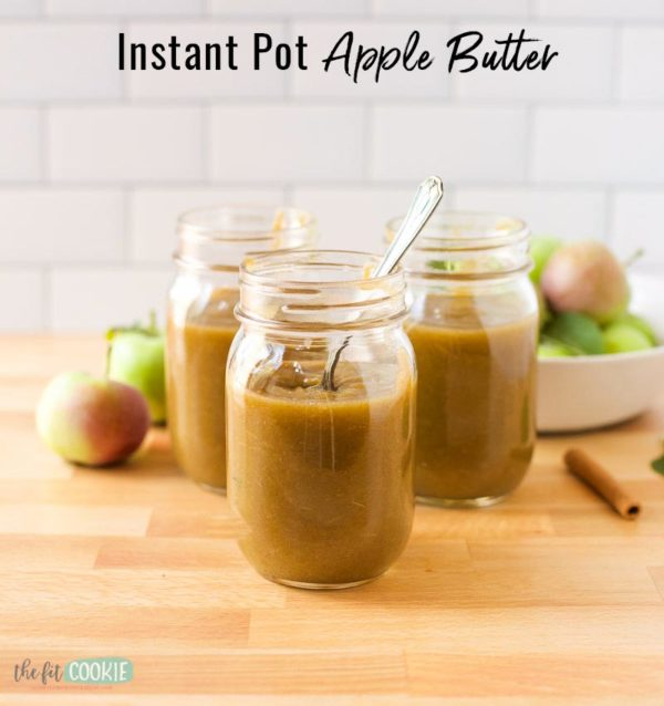 pressure cooker apple butter in jars on a wood cutting board