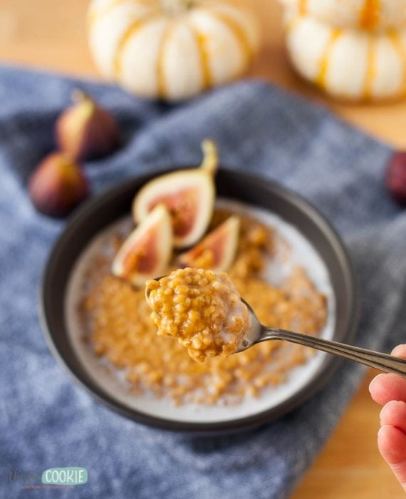 pumpkin spice instant pot oatmeal in a black bowl and on a spoon