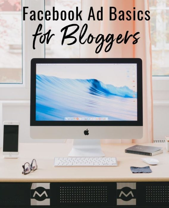 """photo of computer on desk with words """"facebook ad basics for bloggers"""""""