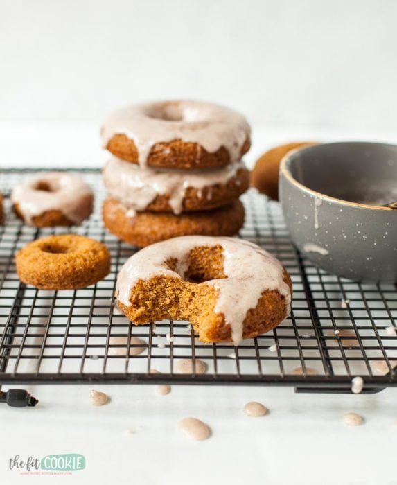 vegan baked donuts made with pumpkin and topped with cinnamon glaze