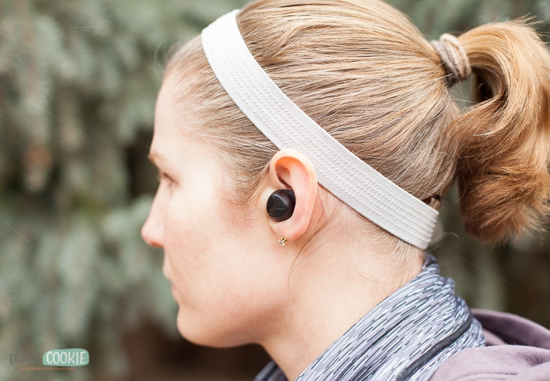 woman wearing a pair of Samsung Galaxy Buds outdoors