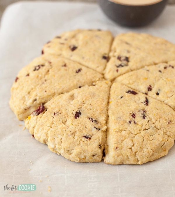 cranberry orange scones on a baking sheet ready to be cut