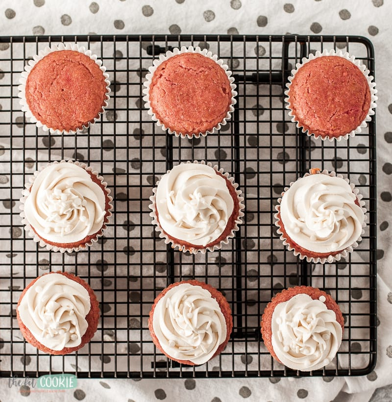 overhead photo of strawberry cupcakes with white frosting