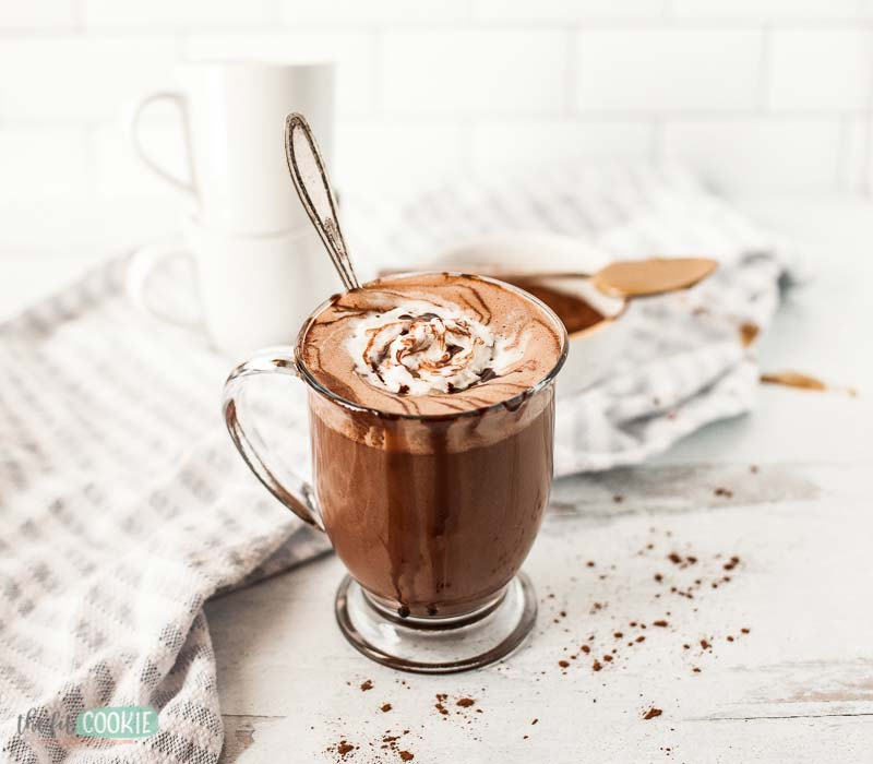 hot cocoa with chocolate drizzle in glass mug