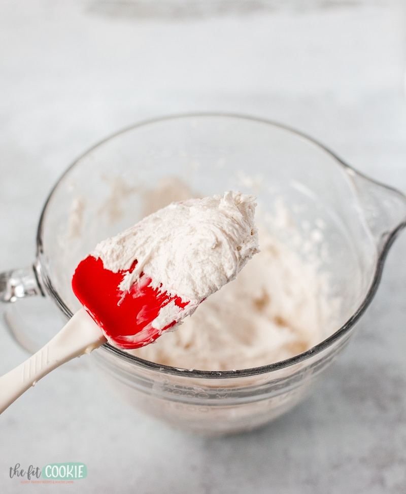 white vanilla frosting on a spoon