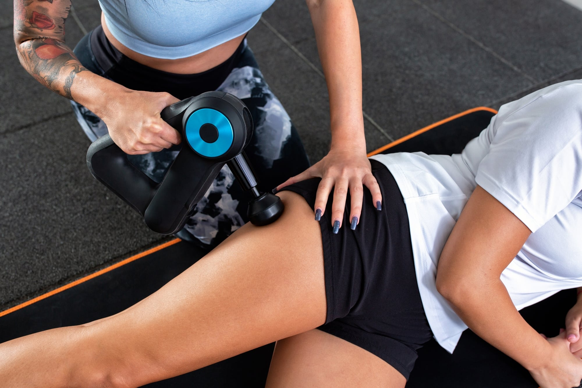 using percussion massager on hips and glutes