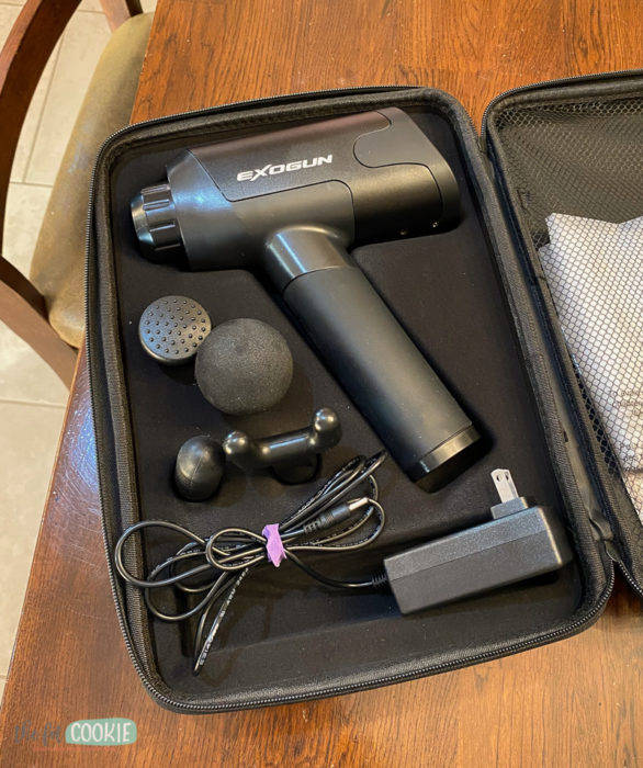 Exogun percussion massager with case and attachments