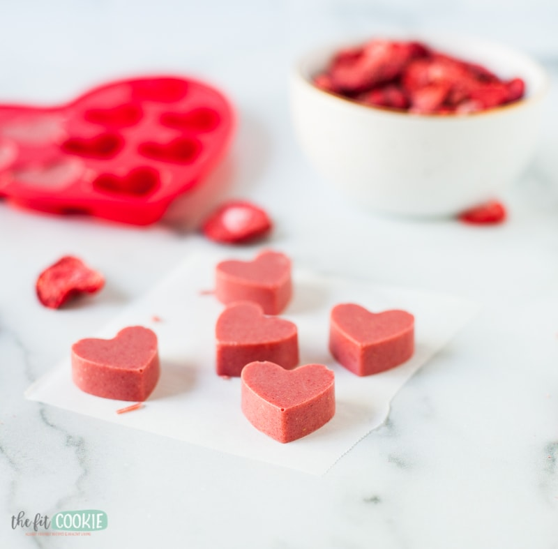 strawberry chocolates on a marble surface