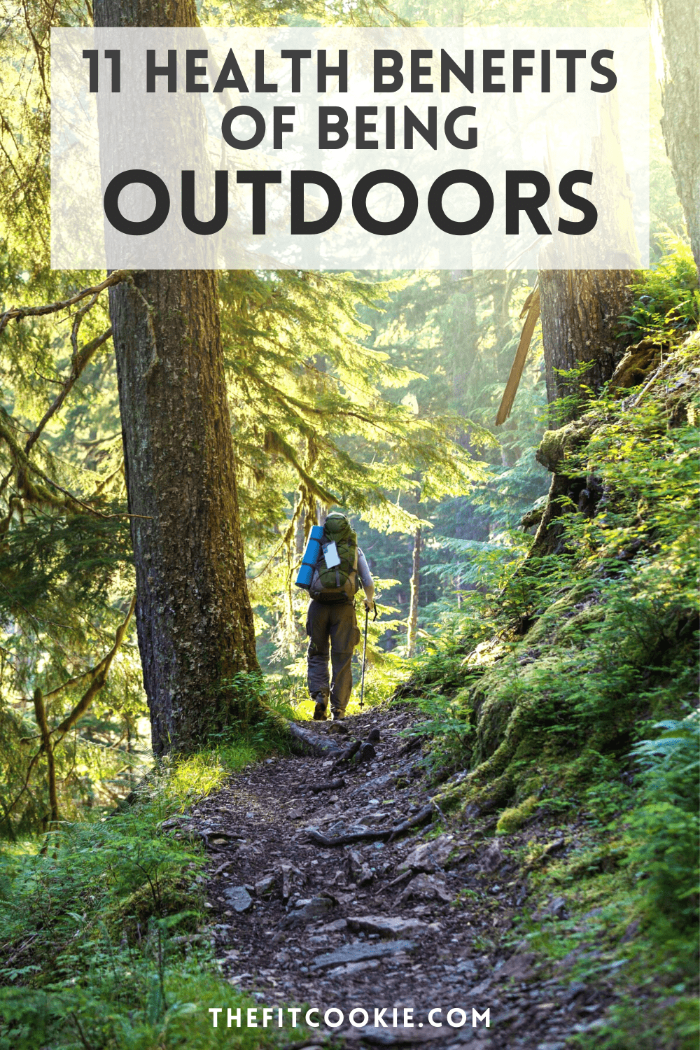 man hiking in the forest with text overlay that says 11 health benefits of being outdoors