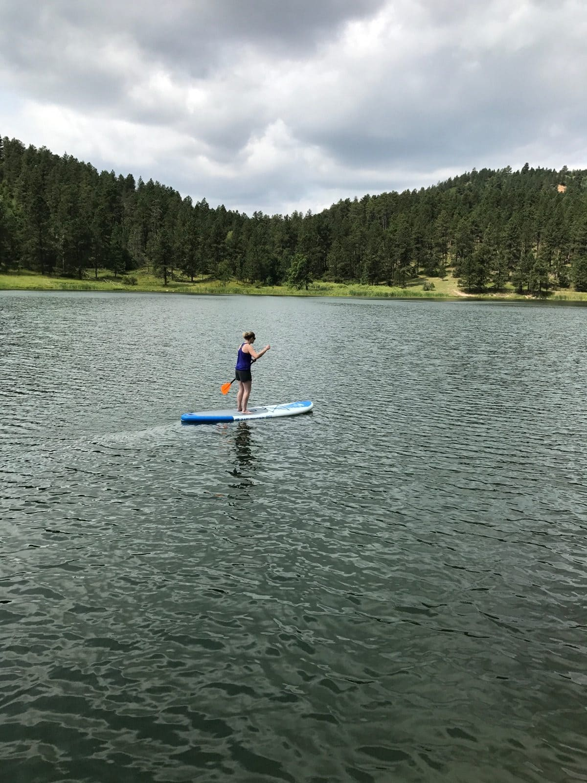 me paddle boarding on a small lake