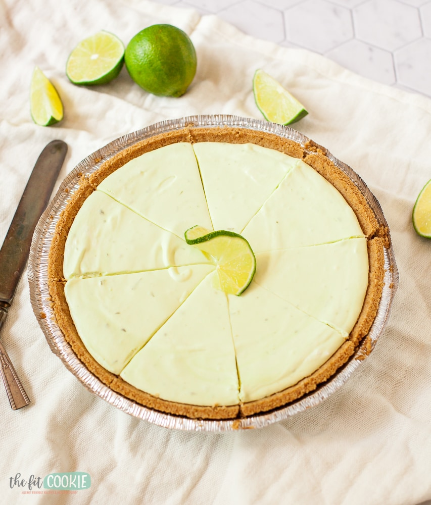 Sliced light green cheesecake in a gluten free crust