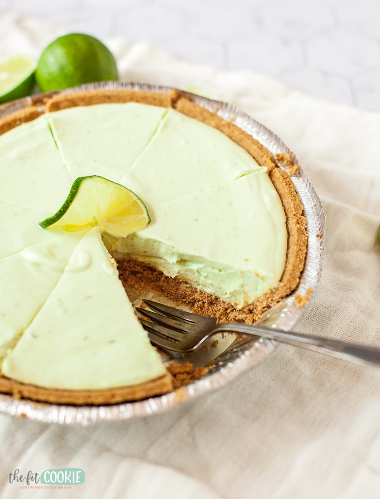sliced dairy free key lime cheesecake with slice removed