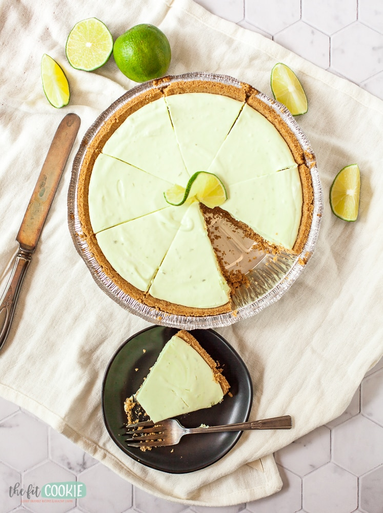 overhead photo of key lime cheesecake with slice removed