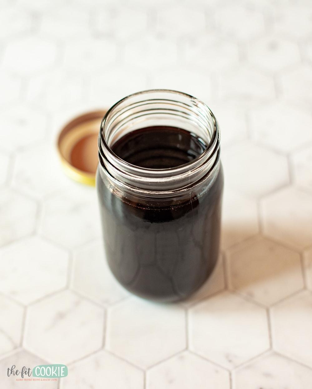 jar of homemade elderberry syrup