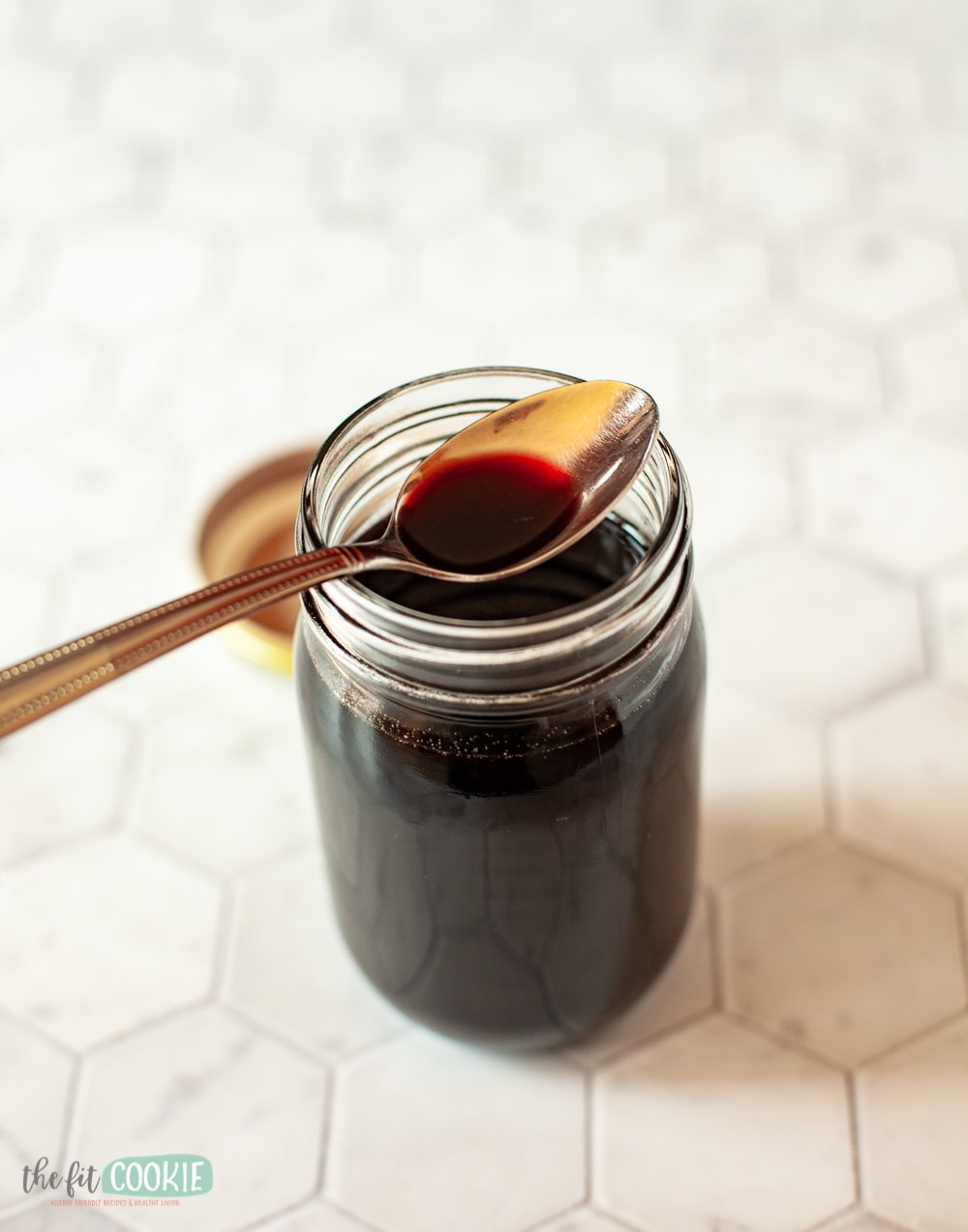 jar of elderberry syrup with spoon