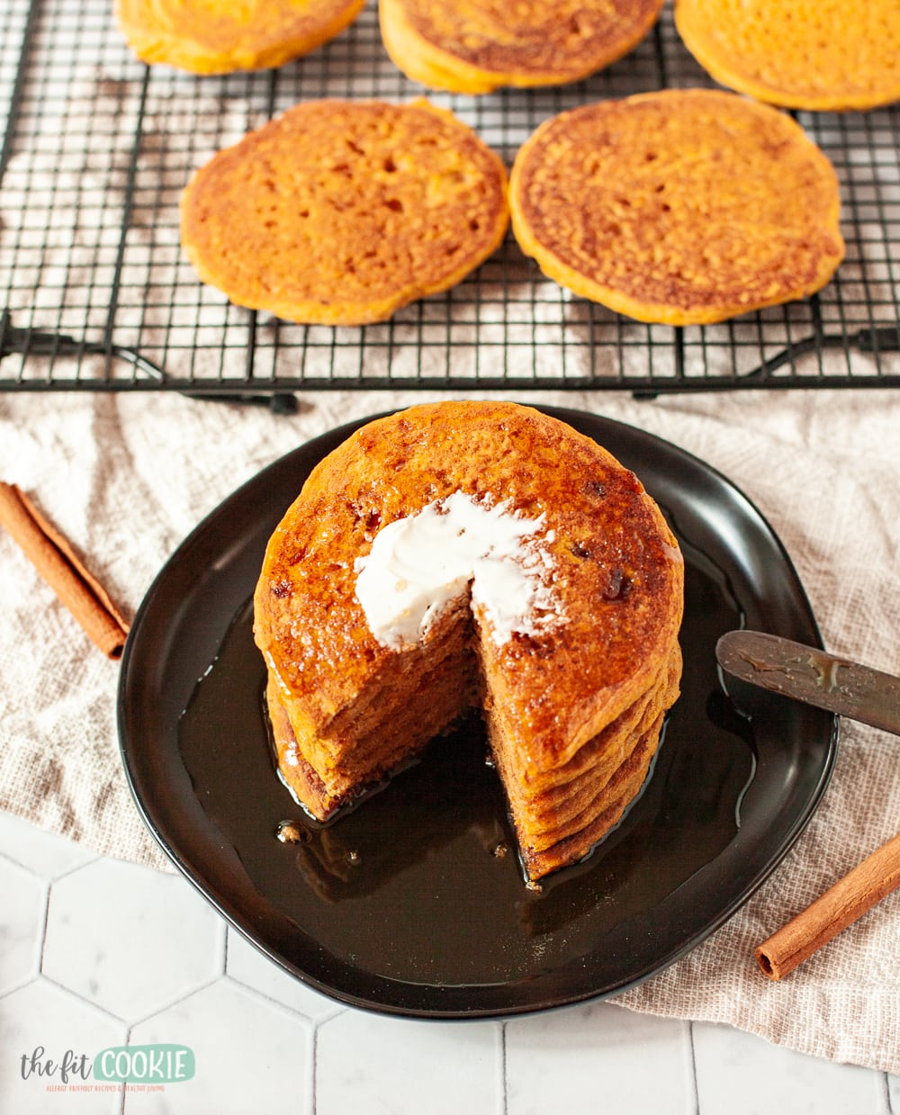 stack of pumpkin pancakes with slices cut out