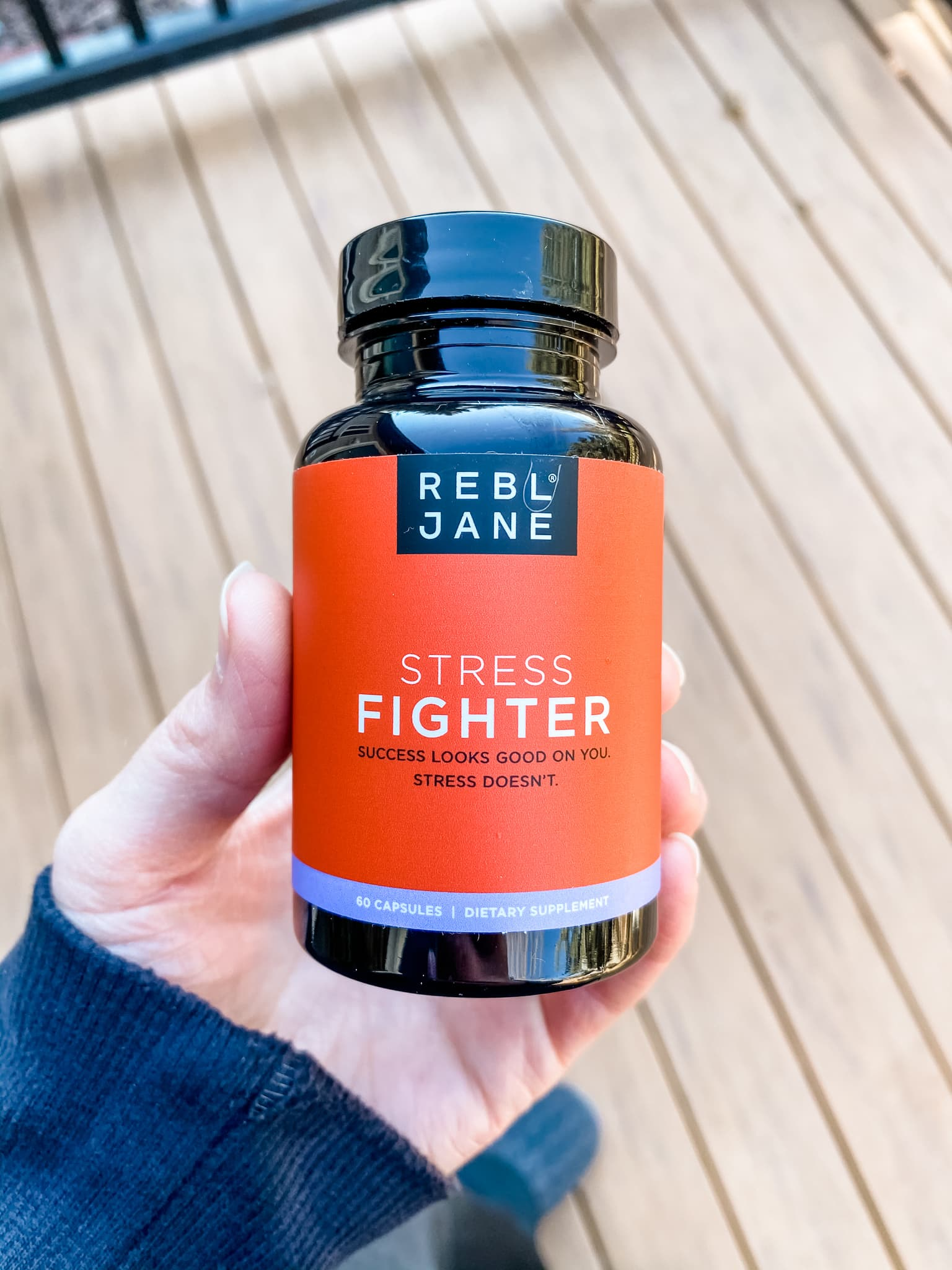 hand holding bottle of Real Jane stress supplement