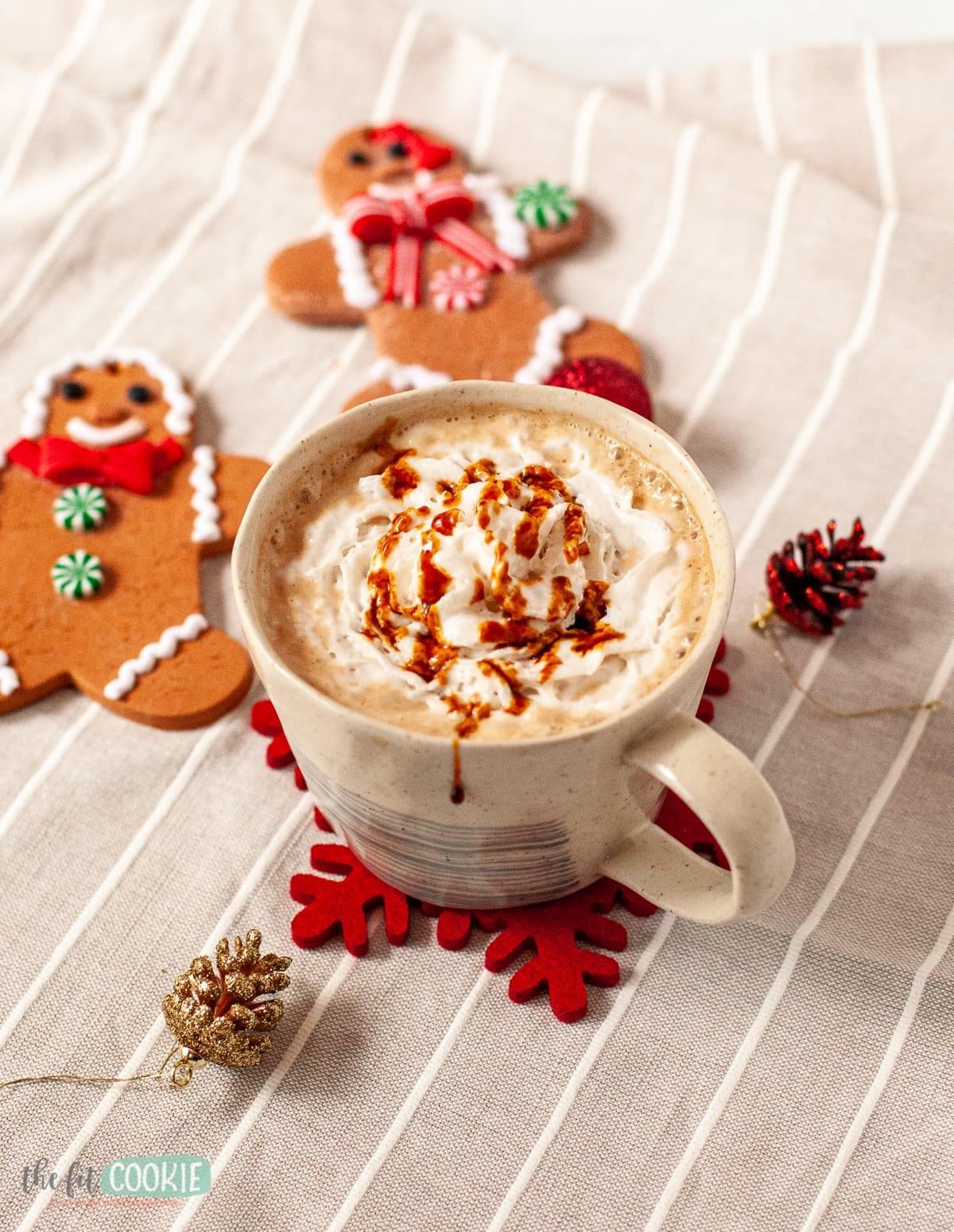 mug of gingerbread latte on a striped napkin
