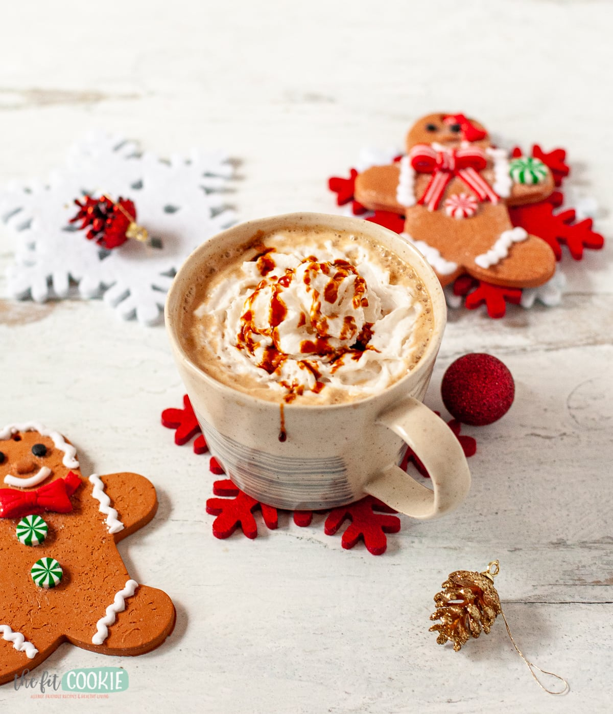 dairy free gingerbread latte in a mug topped with whipped cream