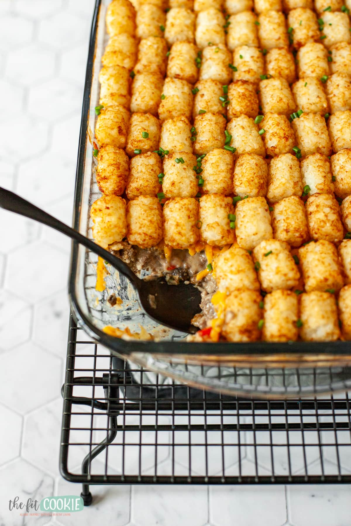 Glass pan of casserole on a cooling rack