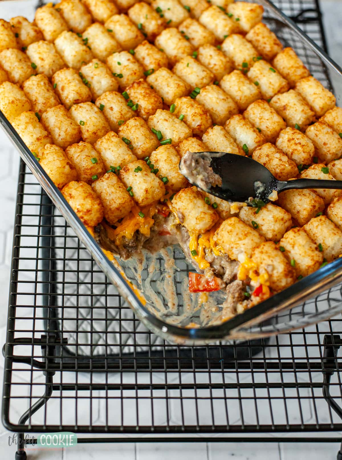 dairy free tater tot casserole in a glass baking dish
