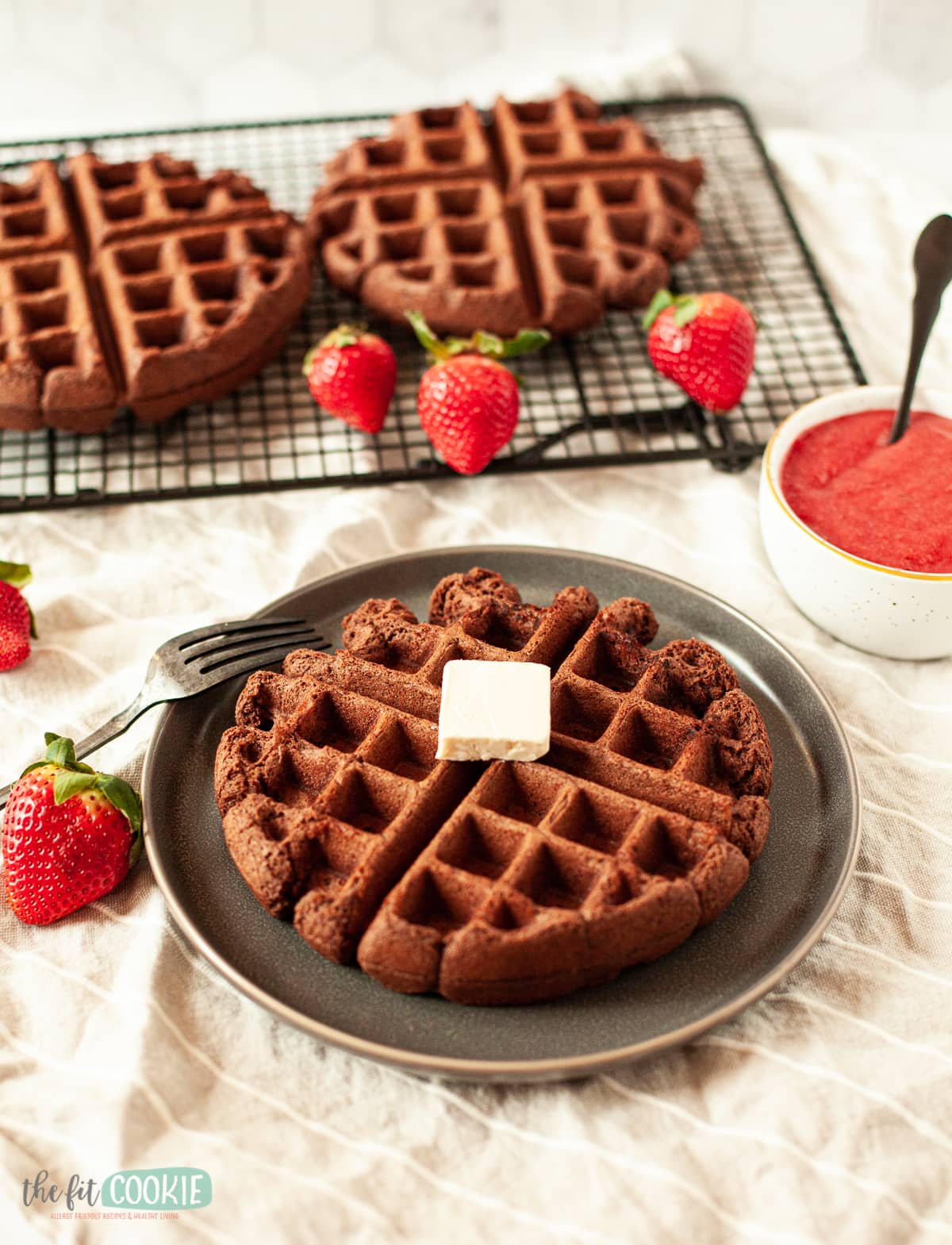 photo of dairy free chocolate waffles with butter on a plate