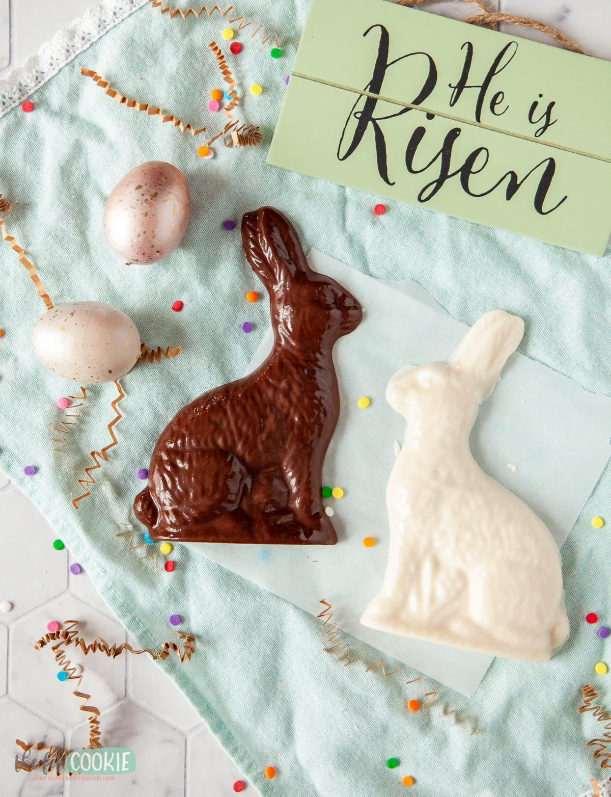chocolate easter bunny and white chocolate easter bunny on a blue napkin