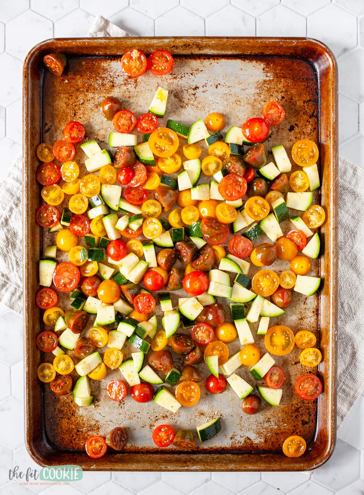 sheet pan with chopped vegetables on it