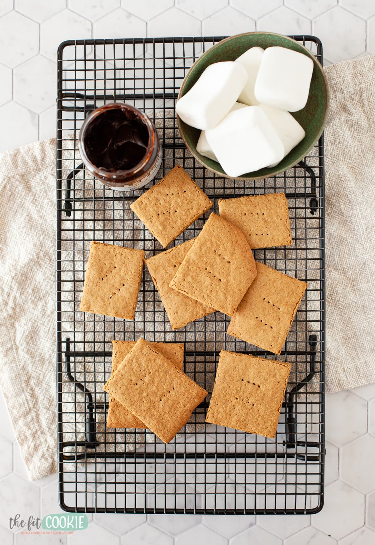overhead photo of homemade graham crackers on a black cooling rack
