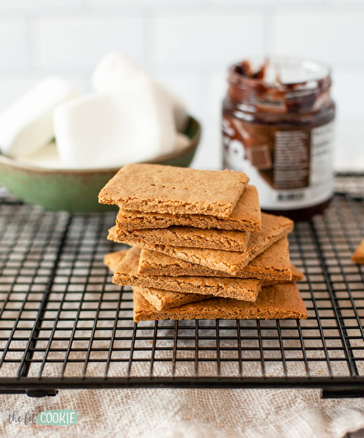stack of dairy free graham crackers on a black cooling rack