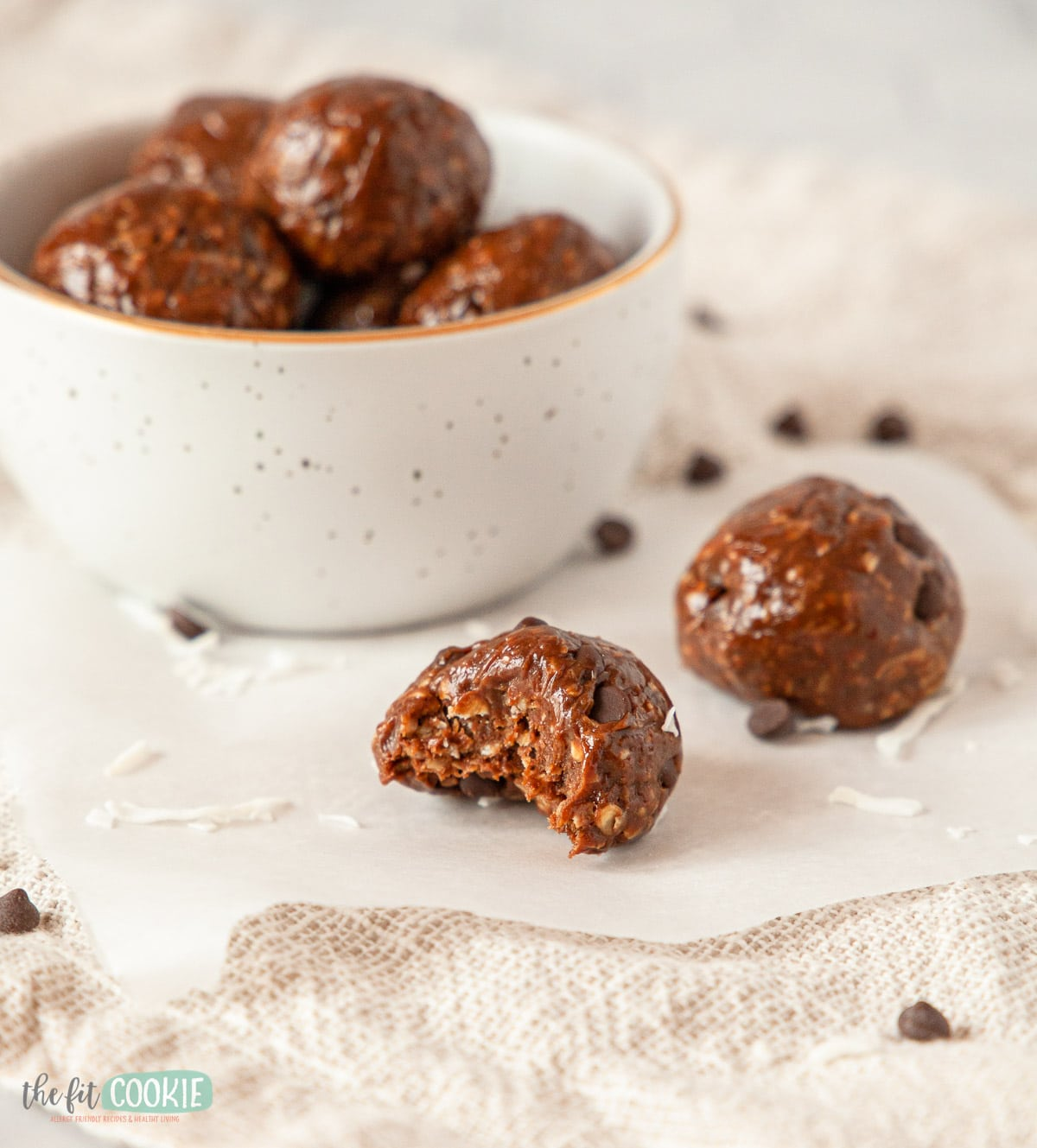 close up photo of chocolate energy ball with a bite taken