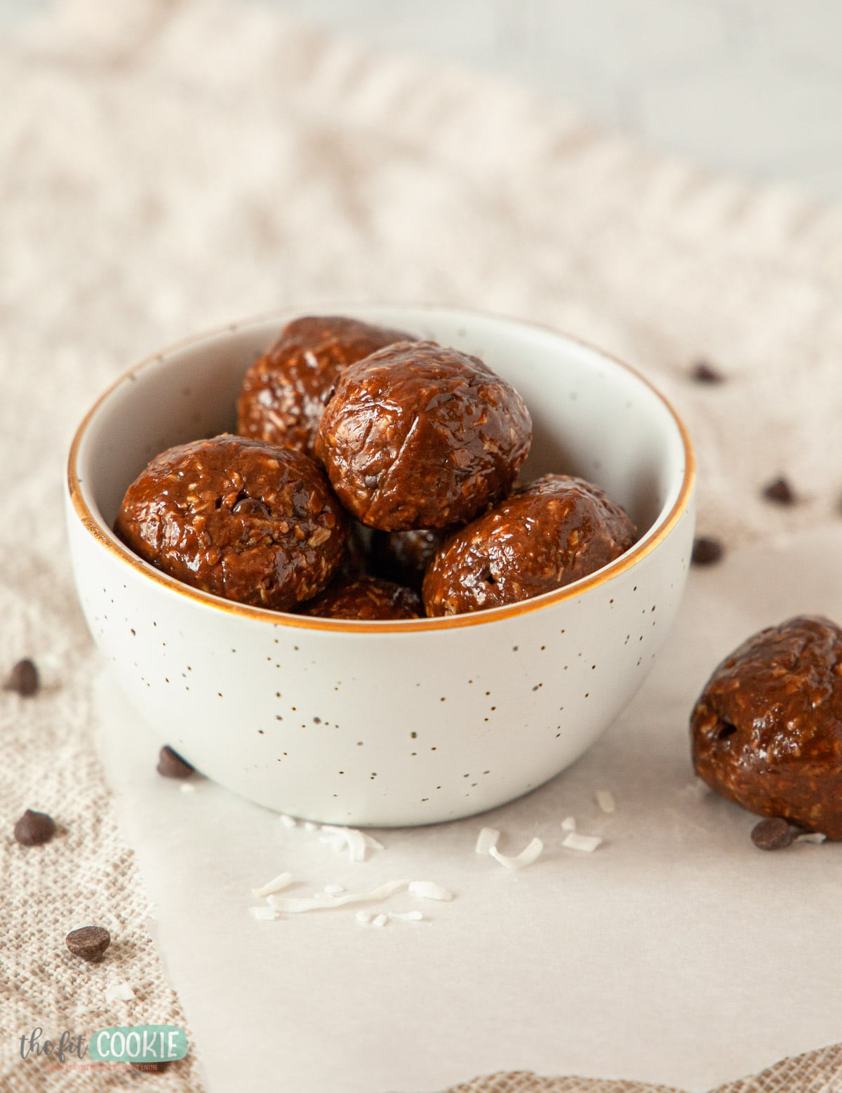 small white bowl filled with chocolate coconut energy bites
