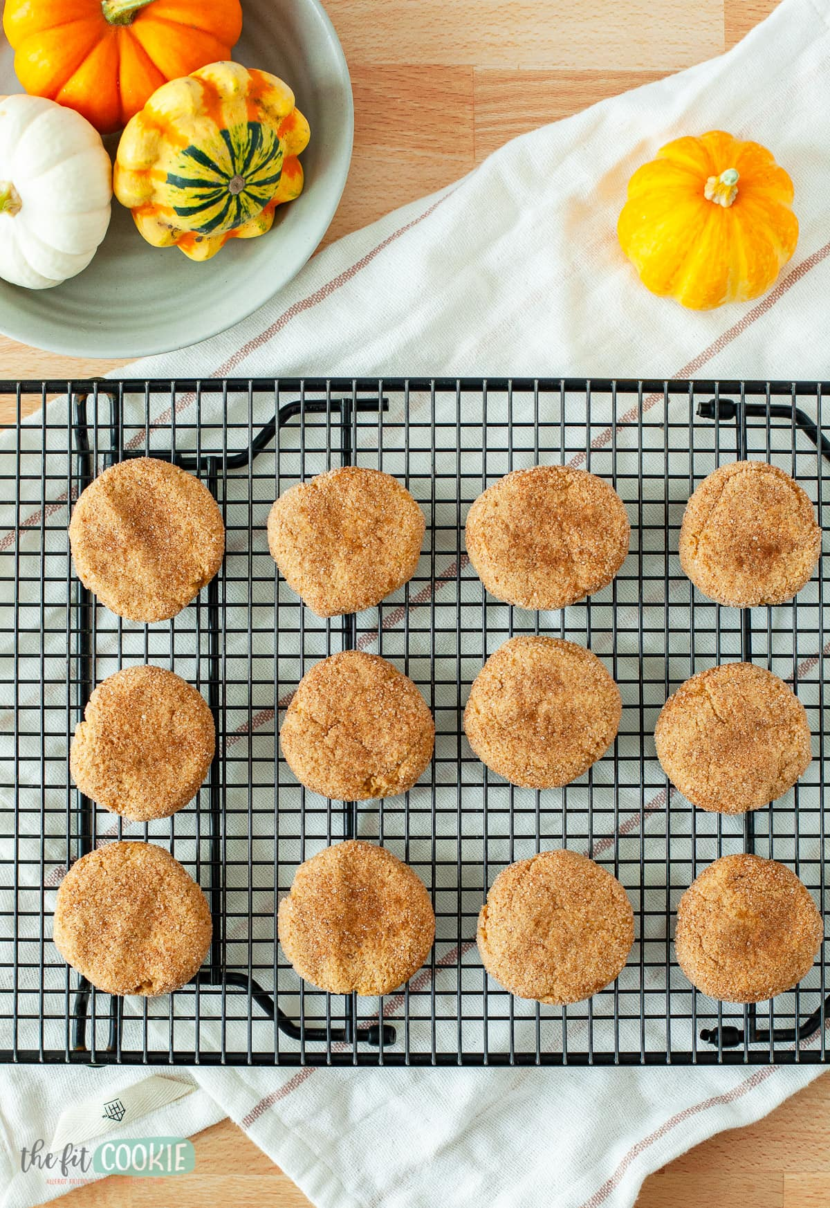 overhead photo of pumpkin snickerdoodle cookies on a black baking rack