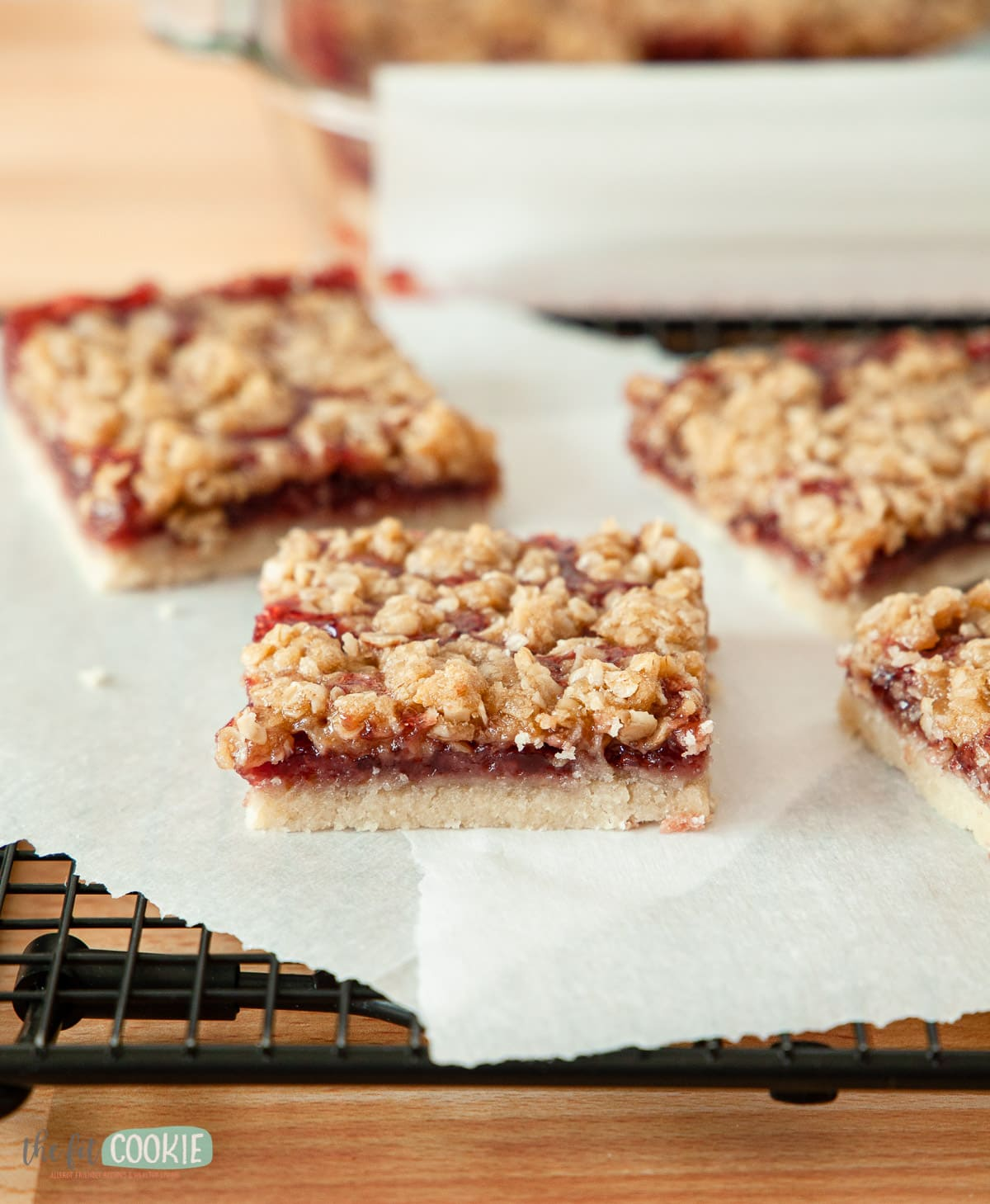 close up photo of a slice of a gluten free raspberry crumb bar