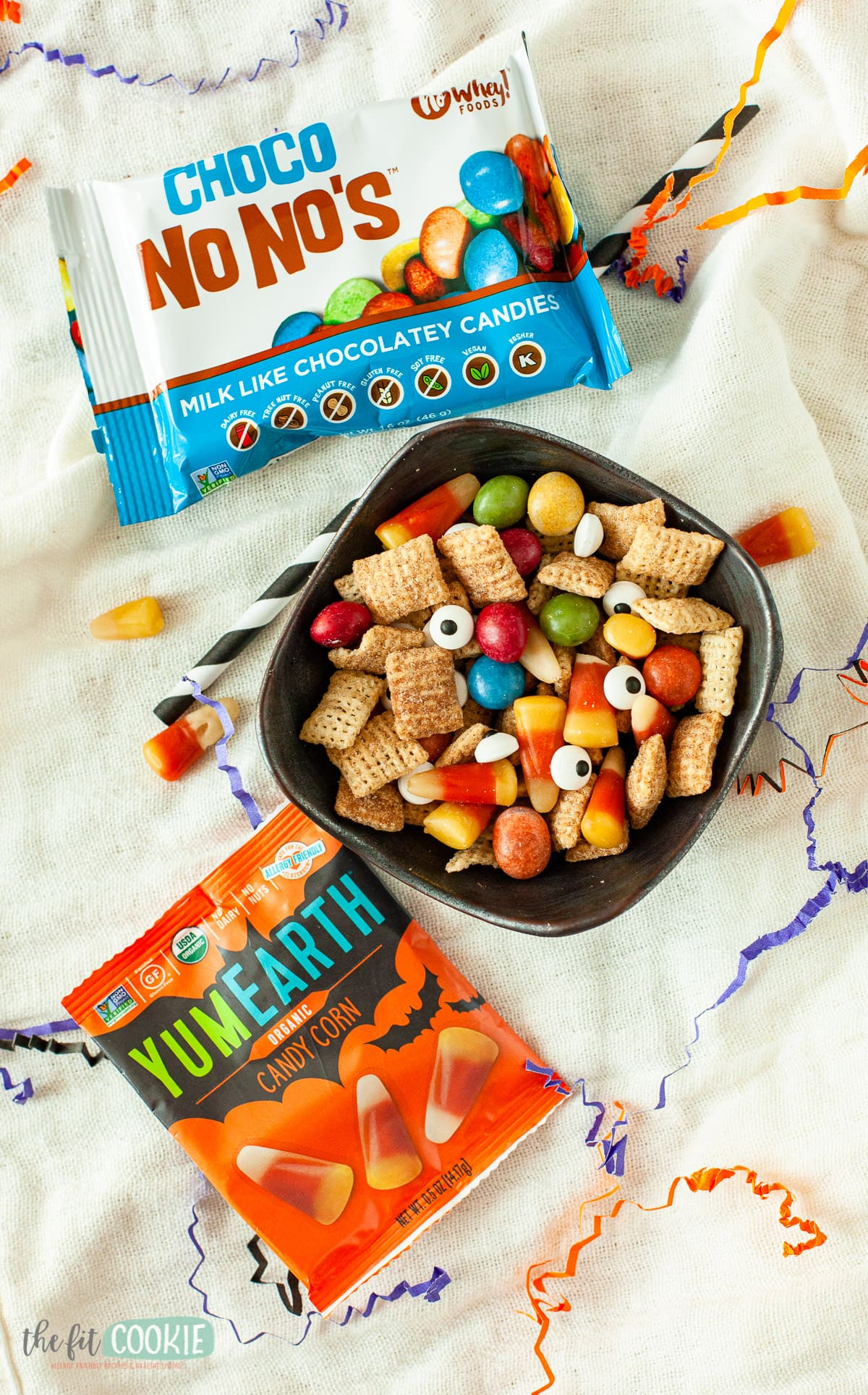 overhead photo of black bowl filled with halloween snack mix