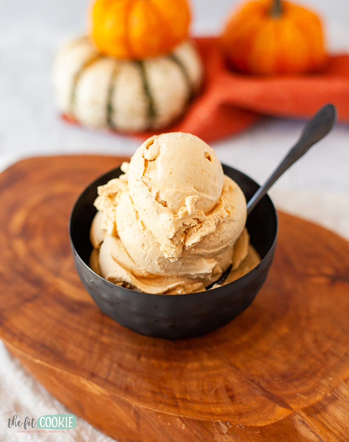 black metal bowl filled with pumpkin pie ice cream